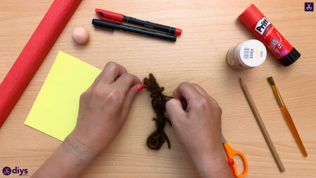 Diy pencil puppet knot