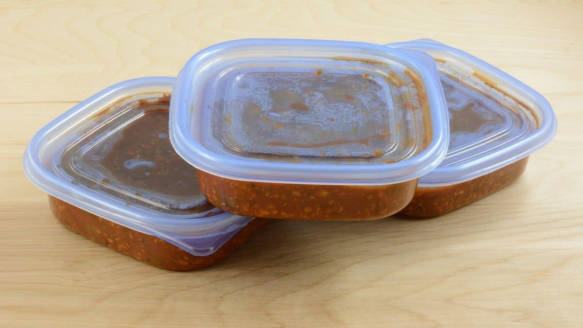Containers showing freezed homemade spaghetti sauce