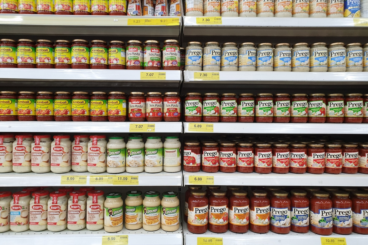 Containers showing spaghetti sauce in the store
