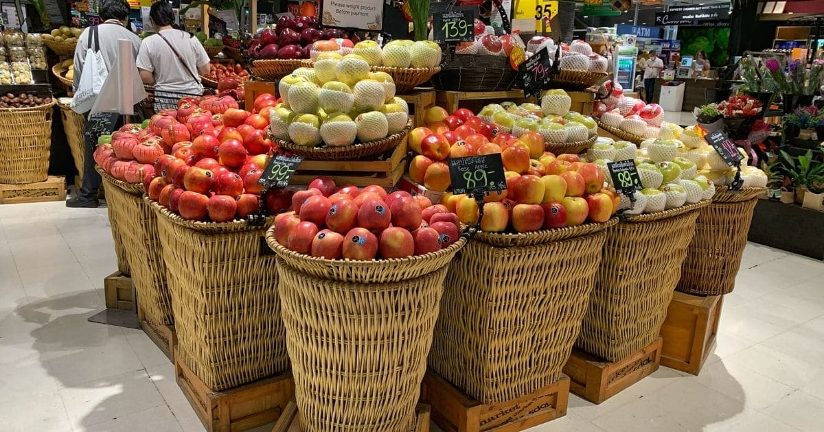 A pictures of loads of apples at the grocery store