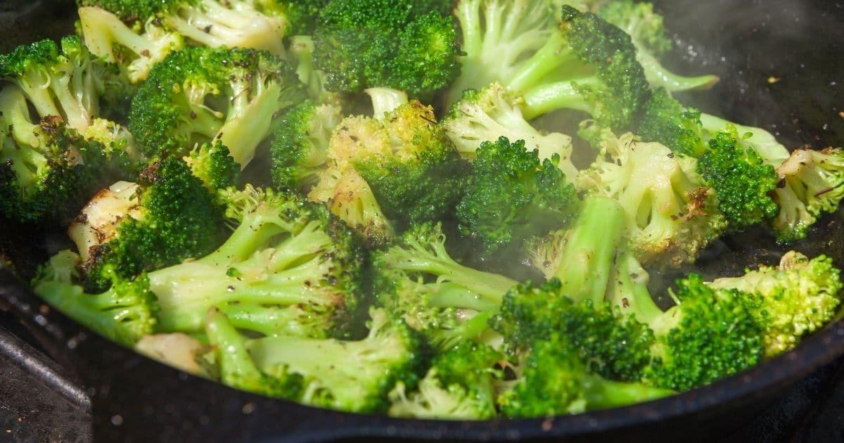 Sauteed broccoli in a pan.