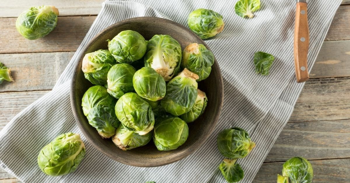 Brussel sprouts in a wooden bowl.
