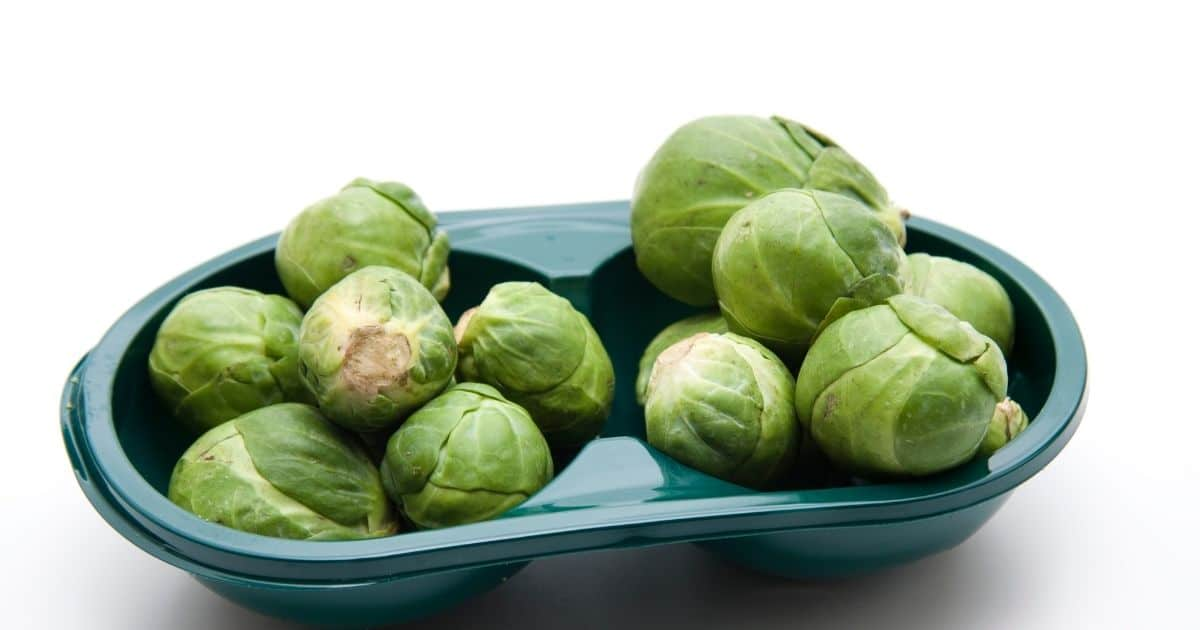 Brussel sprouts in a plastic bowl.