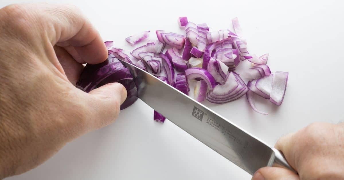 Slicing onions.