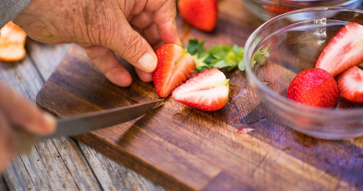 Slicing strawberries.
